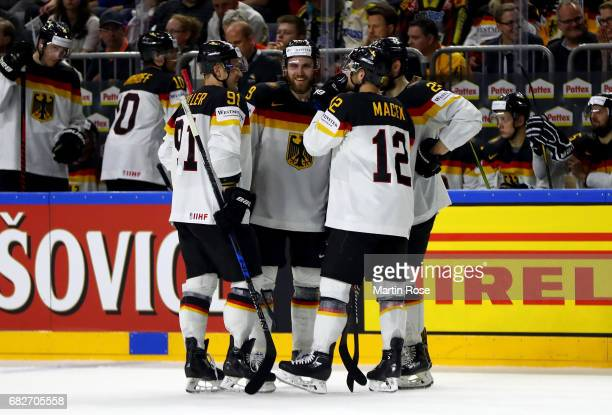 Leon Draisaitl of Germany talks to his team mates during the 2017 IIHF Ice Hockey World Championship game between Italy and Germany at Lanxess Arena...
