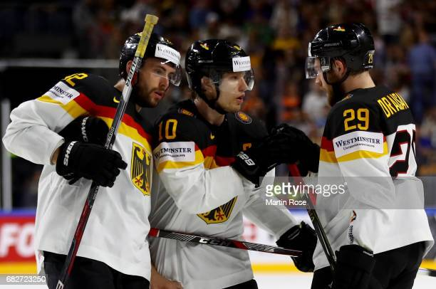 Leon Draisaitl of Germany talks to team mate Matthias Plachta and Christian Ehrhoff during the 2017 IIHF Ice Hockey World Championship game between...