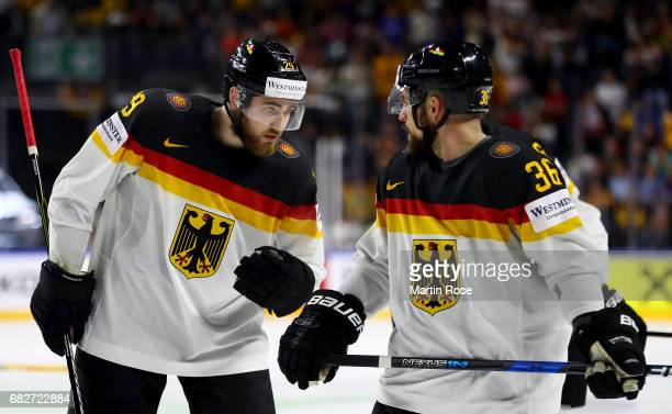 Leon Draisaitl of Germany talks to team mate Yannic Seidenberg during the 2017 IIHF Ice Hockey World Championship game between Italy and Germany at...