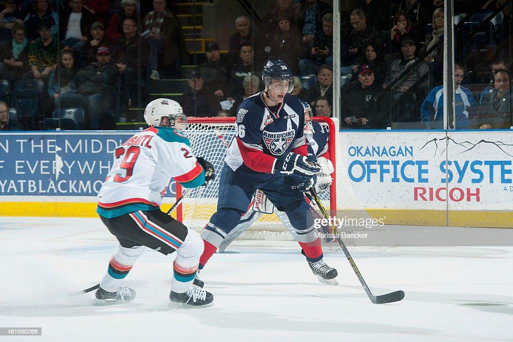 Leon Draisaitl of Kelowna Rockets checks Brandon Carlo of Tri City Americans during third period on January 14 2015 at Prospera Place in Kelowna...