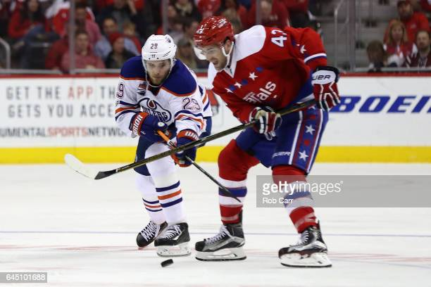 Leon Draisaitl of the Edmonton Oilers and Tom Wilson of the Washington Capitals go after the puck in the third period at Verizon Center on February...