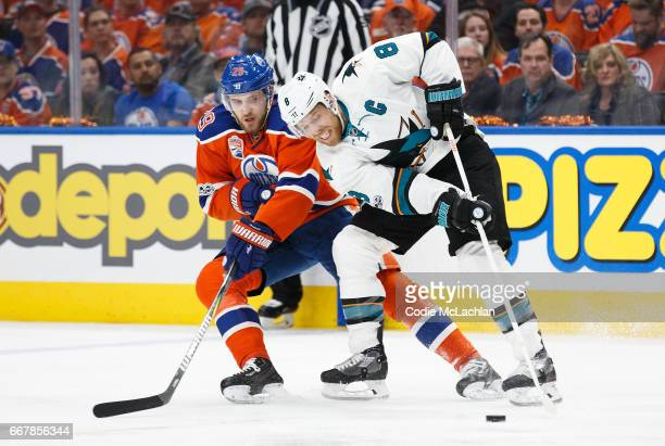 Leon Draisaitl of the Edmonton Oilers battles against Joe Pavelski of the San Jose Sharks in Game One of the Western Conference First Round during...