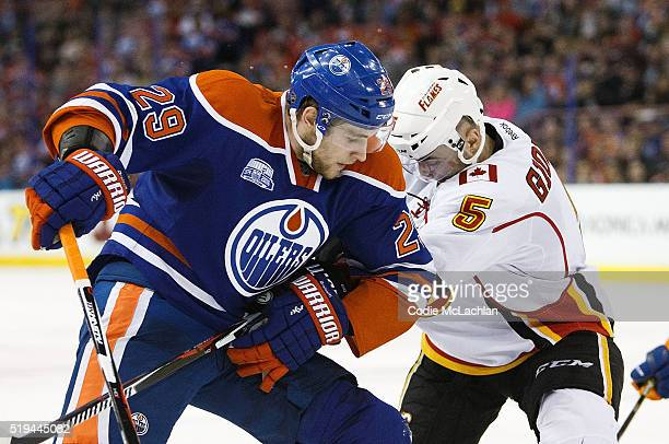 Leon Draisaitl of the Edmonton Oilers battles against Mark Giordano of the Calgary Flames on April 2 2016 at Rexall Place in Edmonton Alberta Canada
