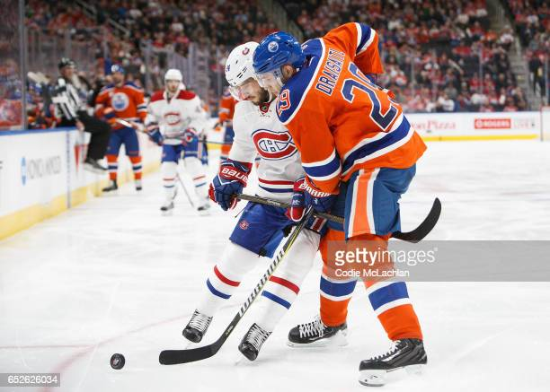 Leon Draisaitl of the Edmonton Oilers battles against Phillip Danault of the Montreal Canadiens on March 12 2017 at Rogers Place in Edmonton Alberta...
