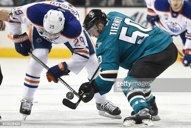 Leon Draisaitl of the Edmonton Oilers battles for a faceoff with Chris Tierney of the San Jose Sharks during the first period in Game Four of the...