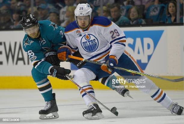 Leon Draisaitl of the Edmonton Oilers battles for control of the puck with Jannik Hansen during the first period in Game Three of the Western...