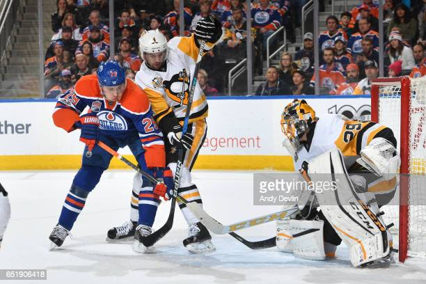 Leon Draisaitl of the Edmonton Oilers battles for position against Justin Schultz of the Pittsburgh Penguins on March 10 2017 at Rogers Place in...