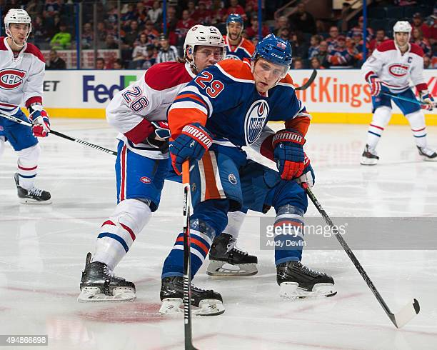 Leon Draisaitl of the Edmonton Oilers battles for the puck against Jeff Petry of the Montreal Canadiens on October 29 2015 at Rexall Place in...