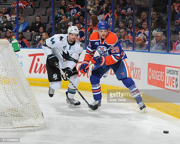 Leon Draisaitl of the Edmonton Oilers battles for the puck against MarcEdouard Vlasic of the San Jose Sharks on March 8 2016 at Rexall Place in...