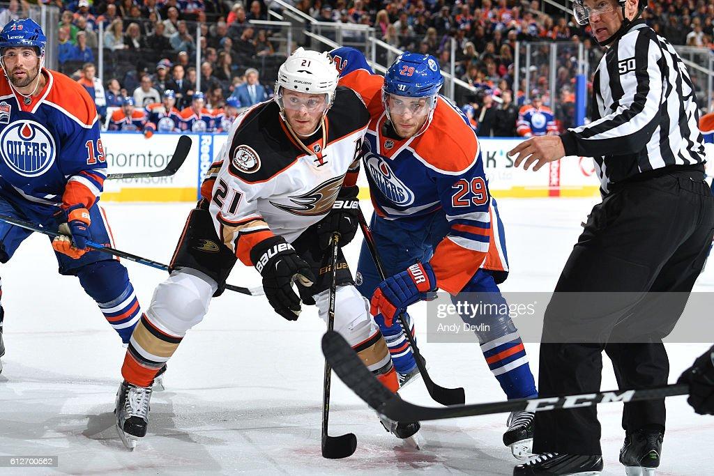 5748f3748 ... Leon Draisaitl 29 of the Edmonton Oilers battles for the puck against  Chris Wagner reebok dri fit t shirt mens ...
