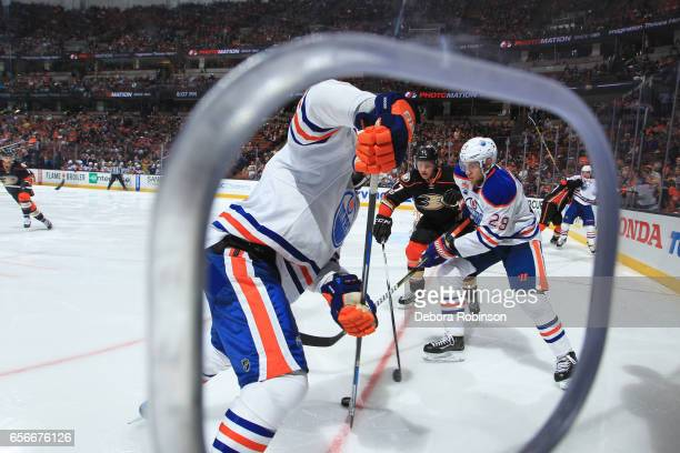 Leon Draisaitl of the Edmonton Oilers battles for the puck against Hampus Lindholm of the Anaheim Ducks during the game on March 22 2017 at Honda...