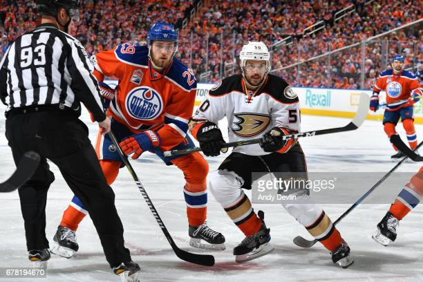 Leon Draisaitl of the Edmonton Oilers battles for the puck against Antoine Vermette of the Anaheim Ducks in Game Four of the Western Conference...