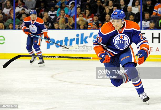 Leon Draisaitl of the Edmonton Oilers chases a loose puck against the Calgary Flames at Rexall Place on September 21 2015 in Edmonton Alberta Canada