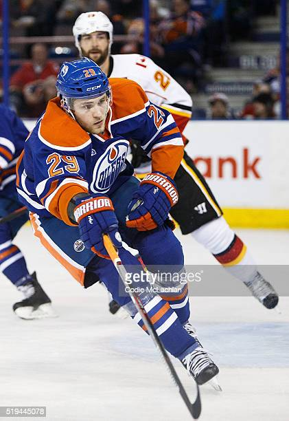 Leon Draisaitl of the Edmonton Oilers is watched by Emile Poirier of the Calgary Flames on April 2 2016 at Rexall Place in Edmonton Alberta Canada
