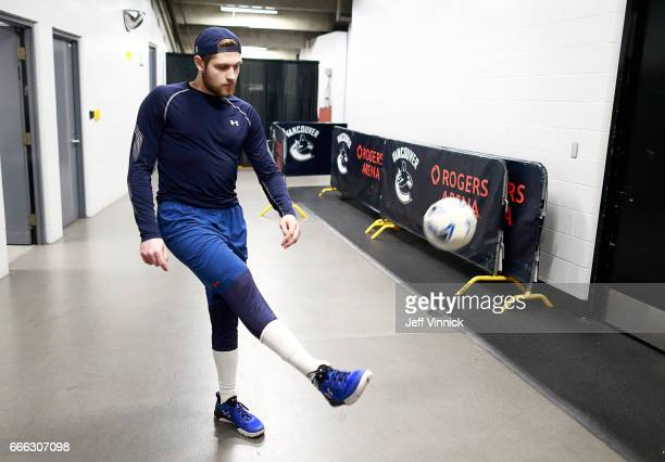 Leon Draisaitl of the Edmonton Oilers kicks a soccer ball as he warms before their NHL game against the Vancouver Canucks at Rogers Arena April 8...
