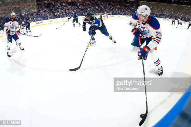 Leon Draisaitl of the Edmonton Oilers looks to pass the puck against David Perron of the St Louis Blues at the Scottrade Center on February 28 2017...