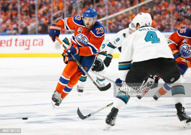 Leon Draisaitl of the Edmonton Oilers makes a pass under pressure from Brenden Dillon of the San Jose Sharks in Game Two of the Western Conference...