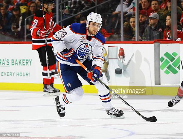 Leon Draisaitl of the Edmonton Oilers plays the puck during the game against the New Jersey Devils at Prudential Center on January 7 2017 in Newark...