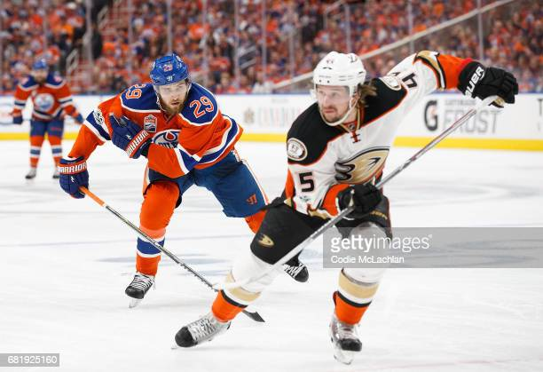 Leon Draisaitl of the Edmonton Oilers pursues Sami Vatanen of the Anaheim Ducks in Game Six of the Western Conference Second Round during the 2017...