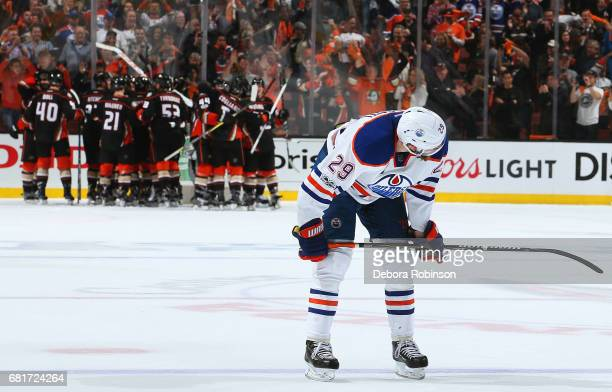 Leon Draisaitl of the Edmonton Oilers reacts as the Anaheim Ducks celebrate their 21 win in Game Seven of the Western Conference Second Round during...