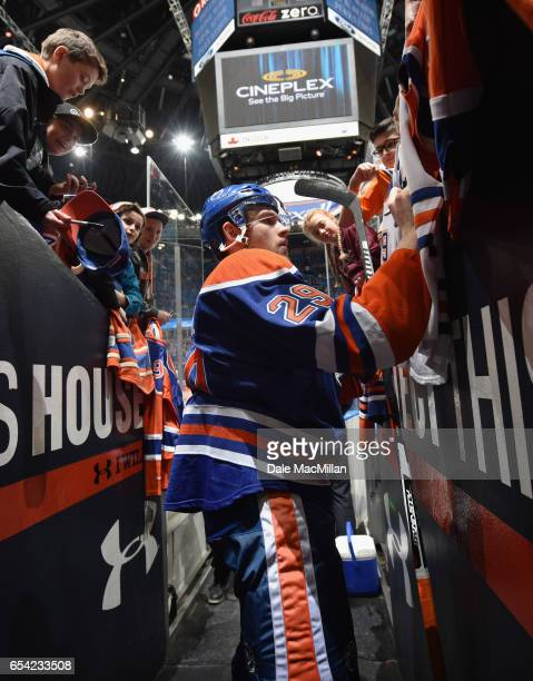 Leon Draisaitl of the Edmonton Oilers signs autographs after the game against the Nashville Predators at Rexall Place on March 14 2016 in Edmonton...