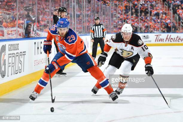 Leon Draisaitl of the Edmonton Oilers skate with the puck while being pursued by Corey Perry of the Anaheim Ducks in Game Four of the Western...