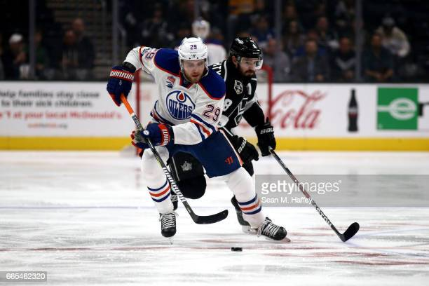 Leon Draisaitl of the Edmonton Oilers skates past Drew Doughty of the Los Angeles Kings during the first period of a game at Staples Center on April...