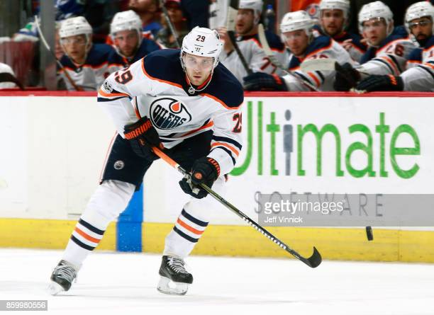 Leon Draisaitl of the Edmonton Oilers skates up ice with the puck during their NHL game against the Vancouver Canucks at Rogers Arena October 7 2017...