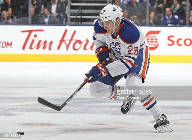 Leon Draisaitl of the Edmonton Oilers skates with the puck against the Toronto Maple Leafs during an NHL game at Air Canada Centre on November 30...