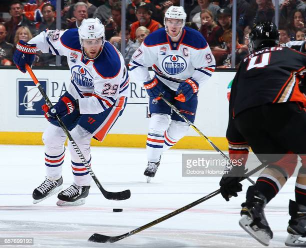 Leon Draisaitl of the Edmonton Oilers skates with the puck followed by Connor McDavid during the game on March 22 2017 at Honda Center in Anaheim...