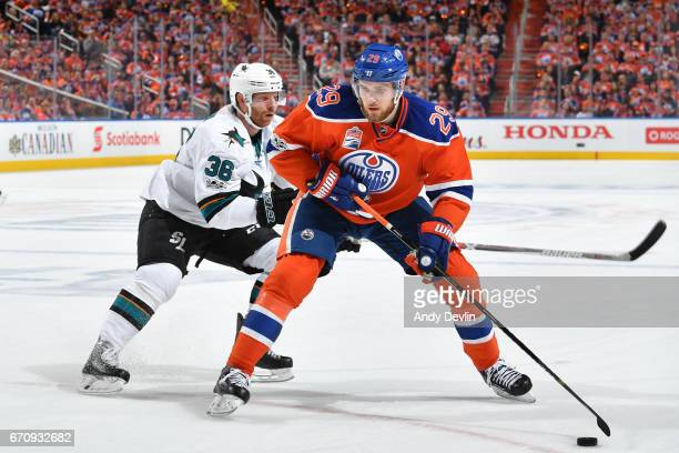 Leon Draisaitl of the Edmonton Oilers skates with the puck while being pursued by Jannik Hansen of the San Jose Sharks in Game Five of the Western...