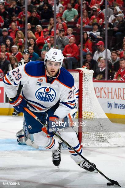 Leon Draisaitl of the Edmonton Oilers takes control of the puck in the third period against the Chicago Blackhawks at the United Center on February...