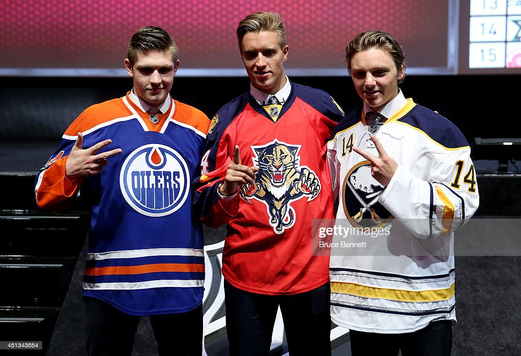 Leon Draisaitl third overall pick by the Edmonton Oilers, Aaron Ekblad first overall pick by the Florida Panthers, and Sam Reinhart the second overall pick by the Buffalo Sabres pose during the first round of the 2014 NHL Draft at the Wells Fargo Center on June 27, 2014 in Philadelphia, Pennsylvania.