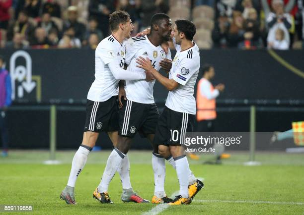 Leon Goretzka and Lars Stindl of Germany celebrate the goal of Antonio Rudiger during the FIFA 2018 World Cup Qualifier between Germany and...