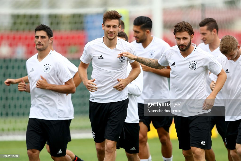 Leon Goretzka (C-L) jokes with Marvin Plattenhardt (C-R) during a team Germany training session at Park Arena training ground on June 18, 2017 in Sochi, Russia. Germany will play against Australia on their Group B FIFA Confederation Cup Russia 2017 match on June 19, 2017 in Sochi, Russia.