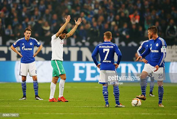 Leon Goretzka Max Meyer and Klaas Jan Huntelaar look dejected as Claudio Pizarro of Werder Bremen celebrates scoring their second goal during the...