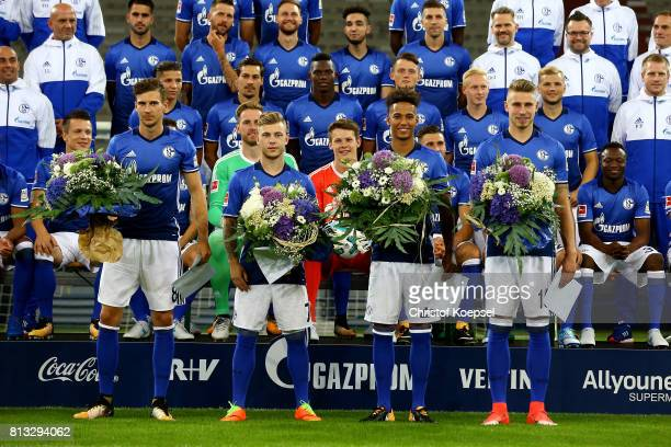 Leon Goretzka Max Meyer Thilo Kehrer and Felix Platte of FC Schalke 04 are honoured winning during the team presentation at Veltins Arena on July 12...