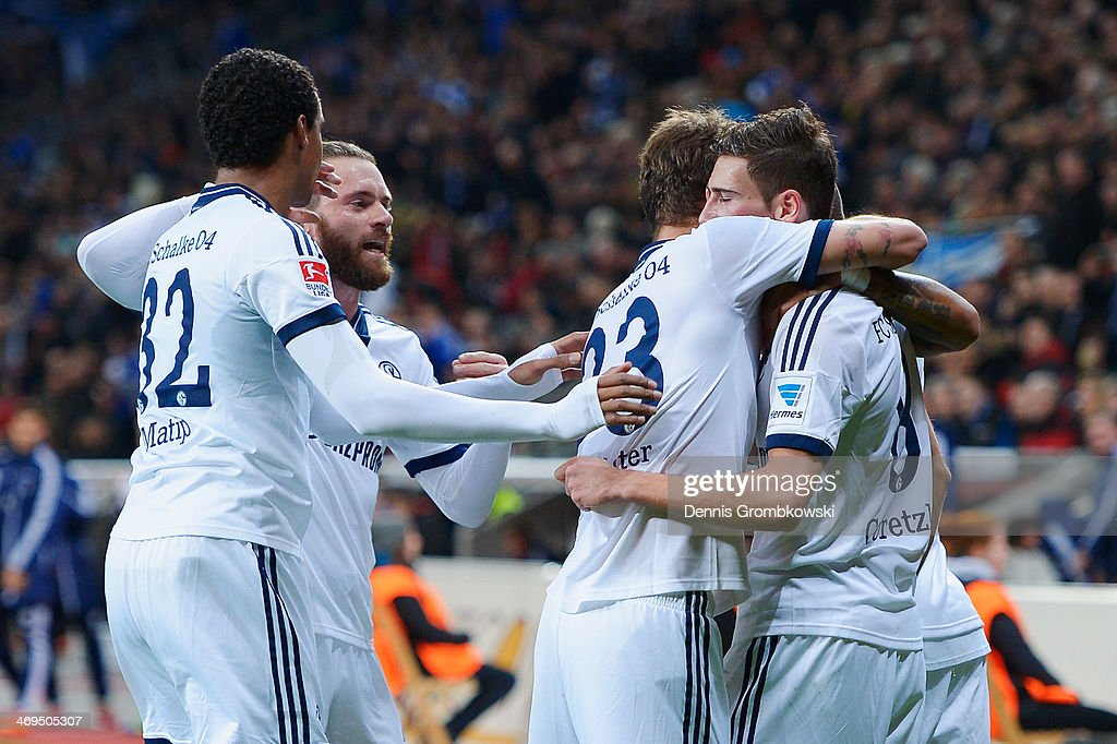 Leon Goretzka of FC Schalke 04 celebrates with team mates after scoring the first goal during the Bundesliga match between Bayer Leverkusen and FC Schalke 04 at BayArena on February 15, 2014 in Leverkusen, Germany.