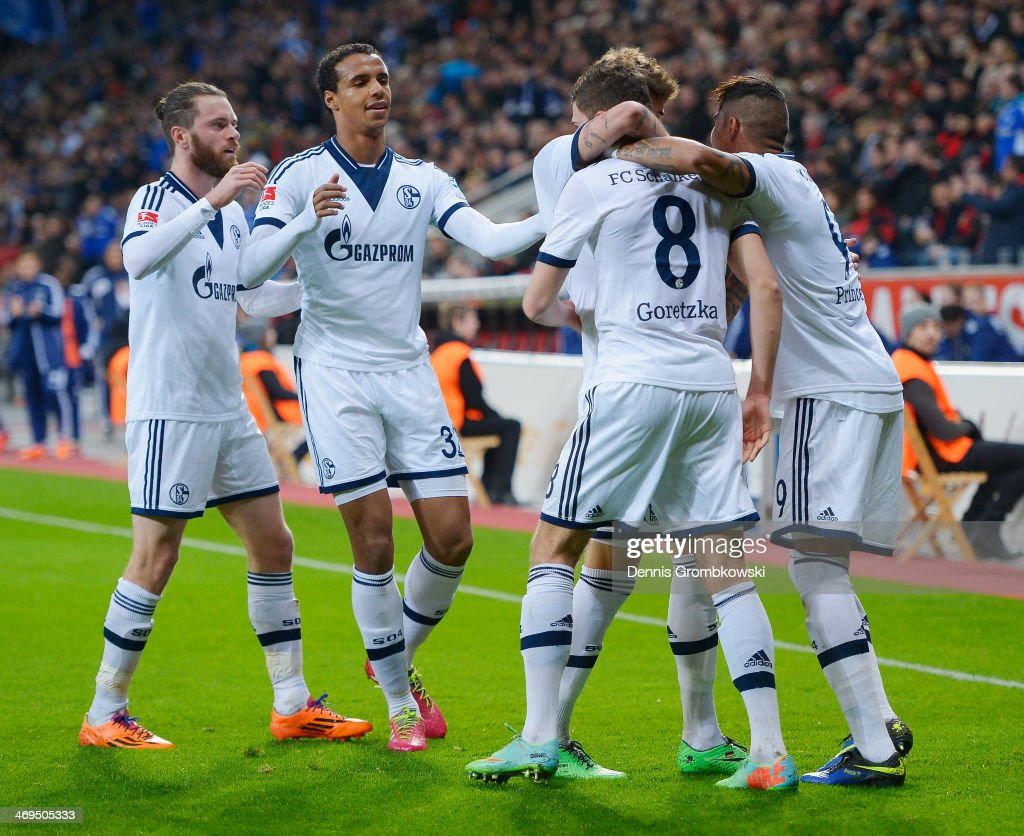 Leon Goretzka of FC Schalke 04 celebrates with team mates after scoring the first goal during the Bundesliga match between Bayer Leverkusen and FC Schalke 04 at BayArena on February 15, 2014 in Leverkusen, Germany.
