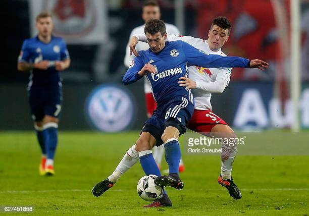 Leon Goretzka of FC Schalke 04 is challenged by Diego Demme of RB Leipzig during the Bundesliga match between RB Leipzig and FC Schalke 04 at Red...