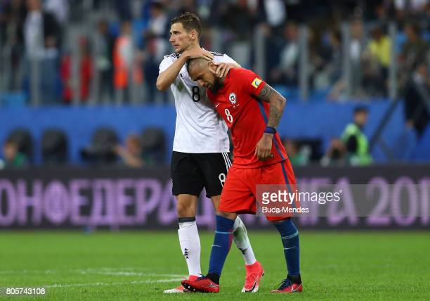 Leon Goretzka of Germany and Arturo Vidal of Chile embrace after the FIFA Confederations Cup Russia 2017 Final between Chile and Germany at Saint...