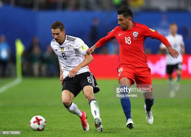 Leon Goretzka of Germany and Gonzalo Jara of Chile battle for possession during the FIFA Confederations Cup Russia 2017 Final between Chile and...