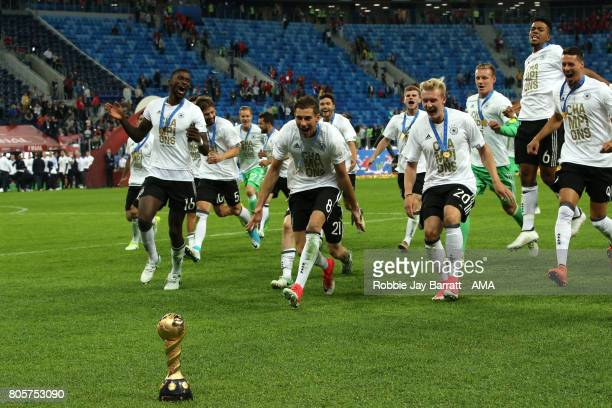 Leon Goretzka of Germany and his teammates celebrate with the trophy at the end of the FIFA Confederations Cup Russia 2017 Final match between Chile...