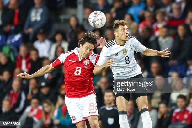 Leon Goretzka of Germany and Thomas Delaney of Denmark battle for the ball during the international friendly match between Denmark v Germany on June...