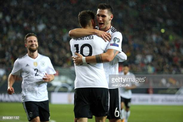 Leon Goretzka of Germany celebrates his goal with Niklas Sule and Shkodran Mustafi during the FIFA 2018 World Cup Qualifier between Germany and...