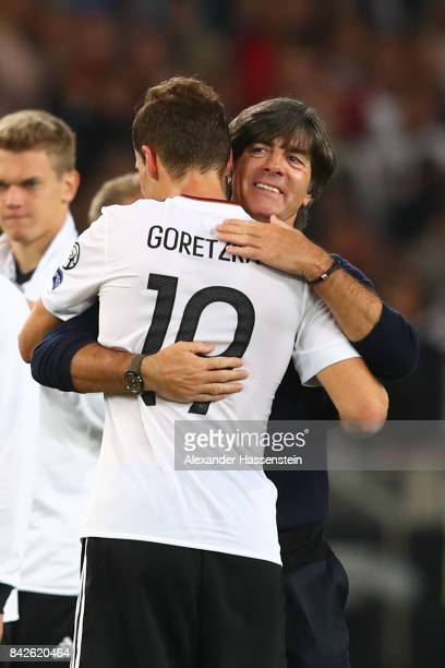 Leon Goretzka of Germany is being hugged by Joachim Loew national coach of Germany after the FIFA 2018 World Cup Qualifier between Germany and Norway...