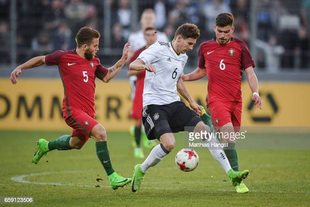 Leon Goretzka of Germany Kevin Rodrigues and Ruben Neves of Portugal battle for the ball during the U21 International Friendly match between Germany...