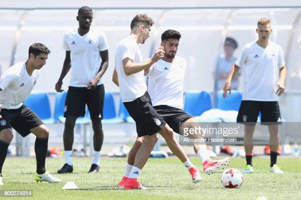 Leon Goretzka of Germany plays the ball with Emre Can of during a Germany training session ahead of their FIFA Confederations Cup Russia 2017 Group B...