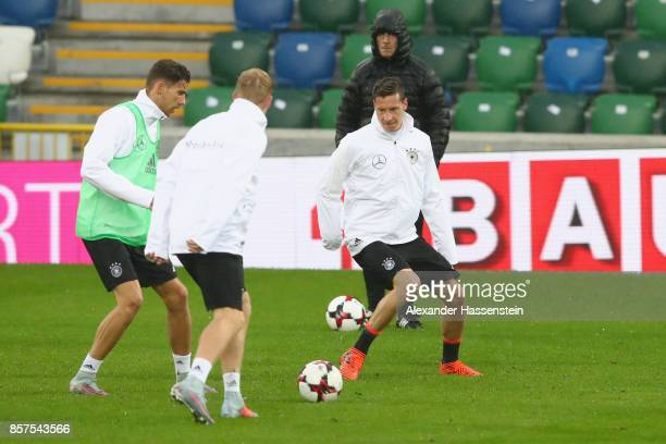 Leon Goretzka of Germany plays the ball with his team mate Julian Draxler during a team Germany training session at Windosor Park ahead of their FIFA...