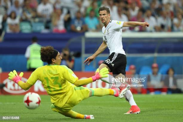 Leon Goretzka of Germany scores the opening goal past Guillermo Ochoa of Mexico during the FIFA Confederations Cup Russia 2017 SemiFinal between...